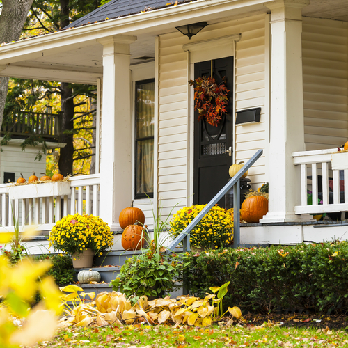 The front porch of a home that is decorated and ready for the autumn season